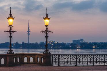 Germany, Hamburg, Outer Alster Lake, Schwanenwik Bridge, Heinrich-Hertz Tower in the evening - KEBF00771
