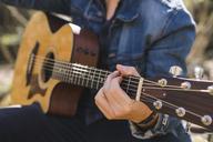 Close-up of man playing guitar outdoors - AFVF00378