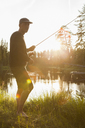 Man with fishing rod in sunlight - FOLF03883