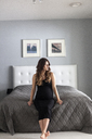 Pregnant woman sitting on bed - FOLF03964