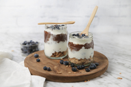 Chia pudding parfait with chocolate and yoghurt with blueberries and granola in jars - RTBF01120