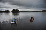 Man paddling canoe on lake - FOLF04330