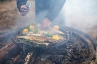 Man cooking on a campfire - FOLF04777