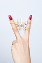 Close-up of clothesline between woman's fingers - SRYF00779