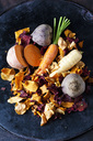 Sliced root vegetables and vegetable chips in bowl - CSF29034