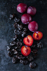 Fresh and dried plums  on dark ground - CSF29043