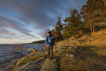 Man walking along coastline - FOLF05200
