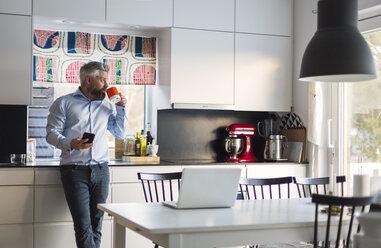 Man drinking coffee in kitchen - FOLF05221
