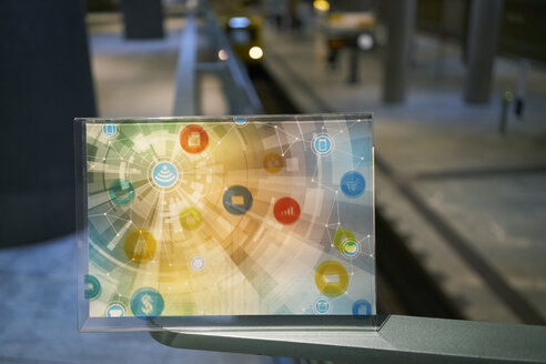 Futuristic device with digital icons at underground station in the city - FMKF05019