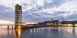 Germany, Baden-Wuerttemberg, Friedrichshafen, Lake Constance, city view and mole tower, harbour mole in the evening - WDF04523
