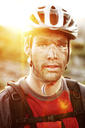 Portrait of male hiker wearing cycling helmet - CAVF31239