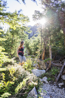 Female hiker hiking in forest at North Cascades National Park - CAVF31350