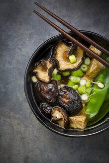 Japanese miso soup with sugar peas, shitake mushrooms, tofu and mung sprouts - LVF06833