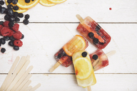 Ice cream and fruits on white wooden background, top view - SKCF00369