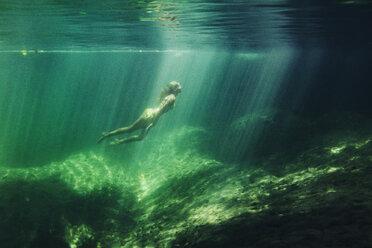 Full length of woman swimming in sea - CAVF31505