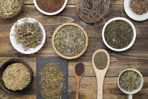 Various herbal infusions on wood, chamimile, mint, rooibos, thyme, green tea, tisane - SKCF00377