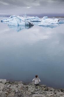 Hiker on shore of Jokulsarlon lake in Iceland - FOLF05873