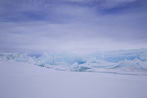 Idyllic view of frozen landscape against sky - CAVF31675
