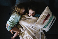 High angle view of sisters sleeping on bed - CAVF31855