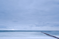 Seascape with breakwater under moody sky - FOLF06018