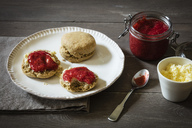 Scones made of einkorn wheat with strawberry jam and clotted cream - EVGF03330