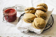 Scones made of einkorn wheat with strawberry jam and clotted cream - EVGF03333