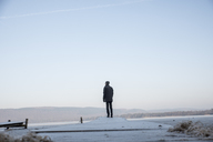 Man standing on a snow covered pier - FOLF06214