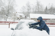 Man clearing snow from his car - FOLF06370