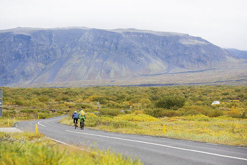 Two cyclists on rural road in Iceland - FOLF06442