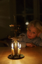 Young boy watching Christmas candles burn - FOLF06505