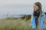 Young girl outside in the long grass - FOLF06535