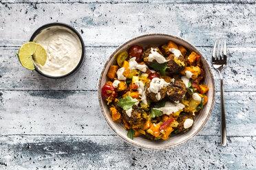 Vegetarian bowl with sweet potato, tomato and falafel, yogurt dip and parsley - SARF03643