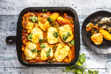 Potato bake, potato, sugar pea, tomato, cheese, parsley in pan - SARF03654