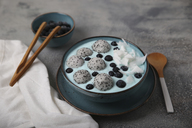 Blue smoothie bowl with grated coconut, blueberries and dragon fruit balls - RTBF01131