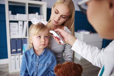 Doctor taking girl's temperature in medical practice - ABIF00217