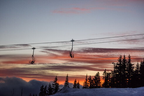 Low angle view of ski lift against cloudy sky during sunset - CAVF32312