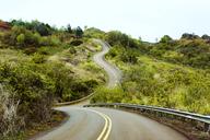 Empty mountain road against sky - CAVF32337
