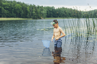 Boy wading and fishing - FOLF06741