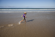 Boy running through water on beach - FOLF06828