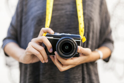 Close-up of woman with camera - VABF01518