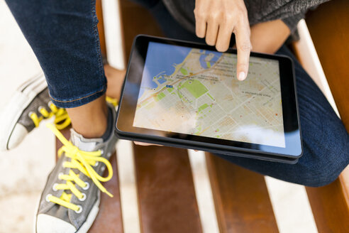 Close-up of woman using tablet with digital street map - VABF01524