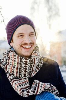 Portrait of smiling man wearing scarf - FOLF07354