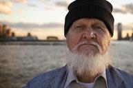 Portrait of senior man wearing knit hat - CAVF33488