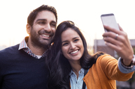 Couple taking selfies at sunset - CAVF33512