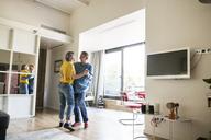 Full length of loving senior couple dancing at home - CAVF33773