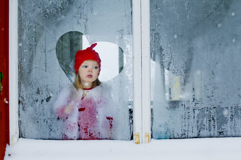 Girl looking through frosted window - FOLF08180