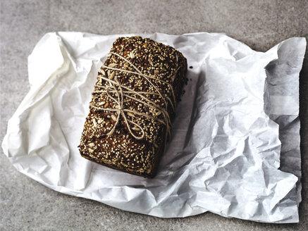 Loaf of bread on paper bag - FOLF08309