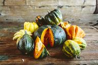 Sliced and whole pumpkins on wood - GIOF03906