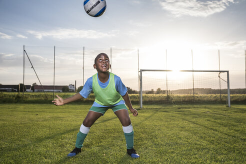 Young football player heading the ball on football ground - WESTF24052