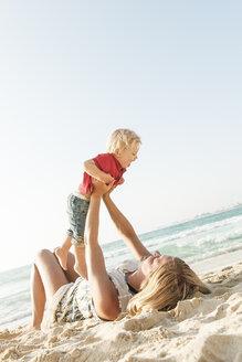 Woman with son on beach in Dubai - FOLF08586